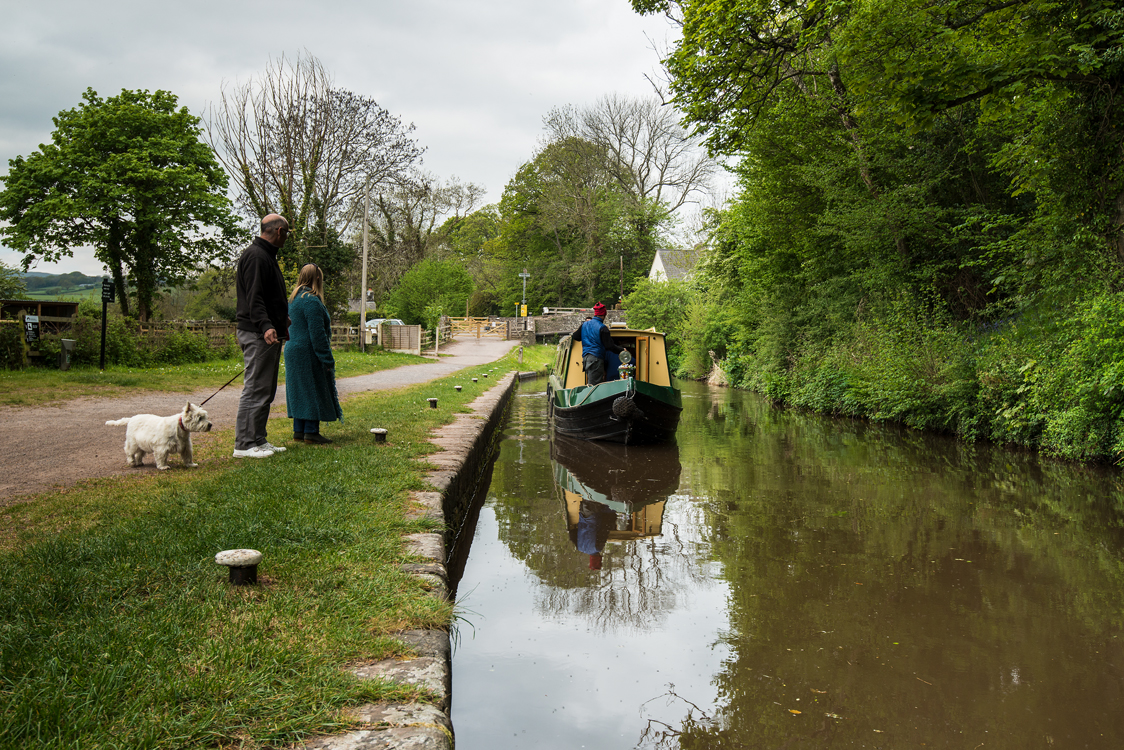 Brecon canal with boat and walkers